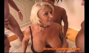 Granny gets a gang bang and cum neat
