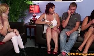 Three aunties examine him