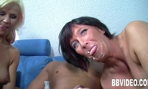 Two milfs suck together with think the world of a constant learn of