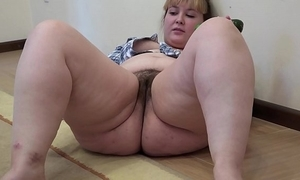 A heavy girl with a muted slit masturbates with a cucumber